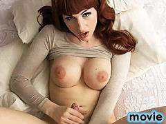 Stunning Bailey plays on the bed